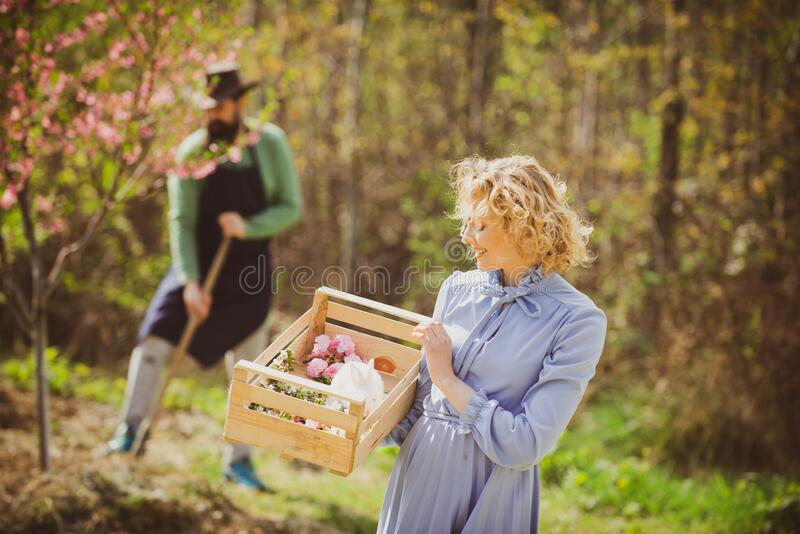 Lifestyle and family life. Image of two happy farmers with instruments. I like spending time on farm. Two people walking royalty free stock photography