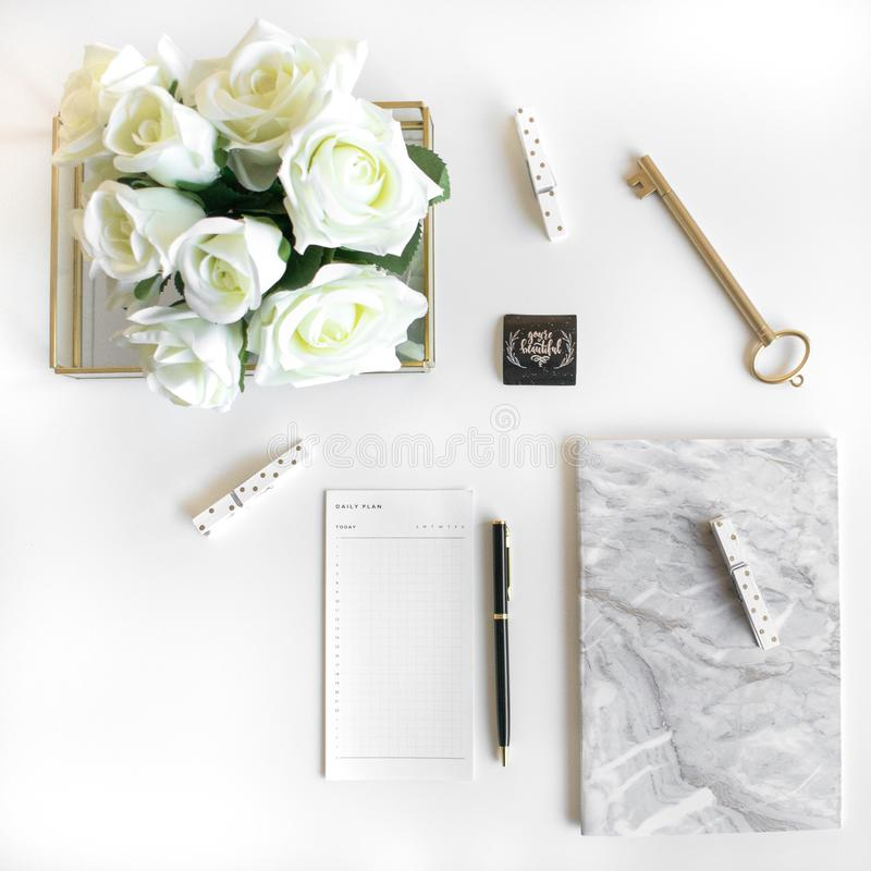 Lifestyle flat lay with accessories. White and gold stock photo