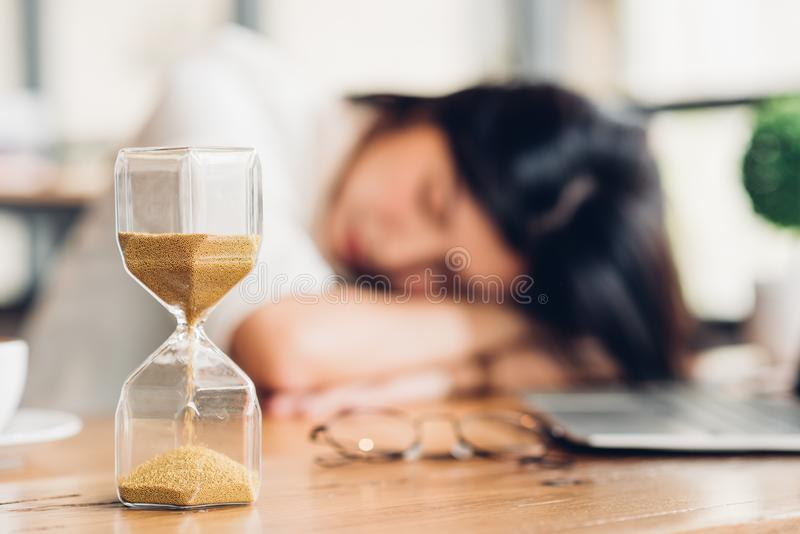 Lifestyle freelance woman he has resting sleeping after hard work long time. In coffee shop royalty free stock image