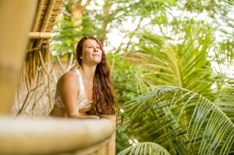 Lifestyle fresh and natural portrait of young beautiful and happy red hair woman smiling cheerful and carefree enjoying Summer. Holidays trip in tropical island stock photography