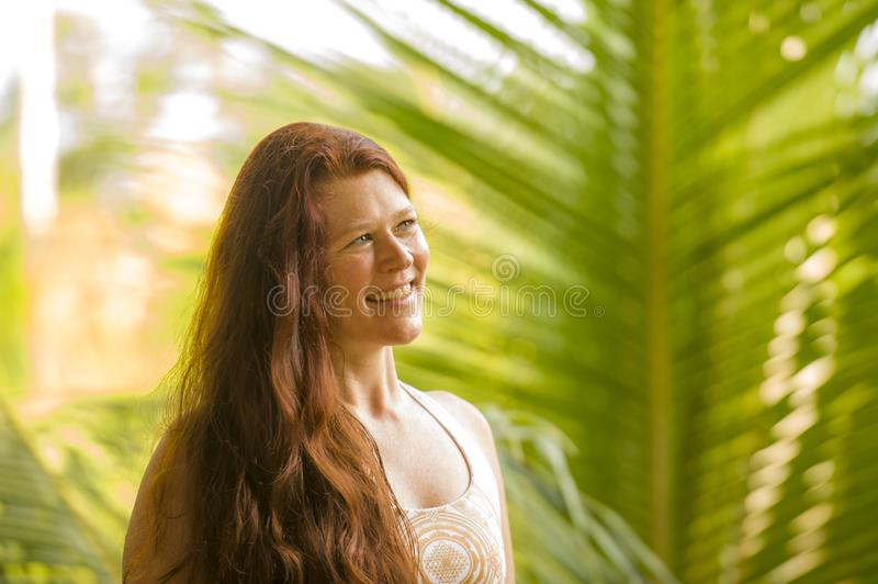 Lifestyle fresh and natural portrait of young beautiful and happy red hair woman smiling cheerful and carefree enjoying Summer. Holidays trip in tropical island royalty free stock images