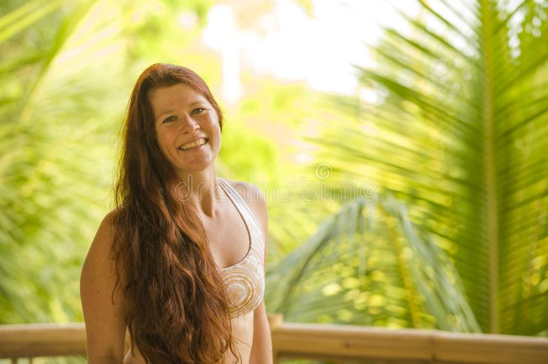 Lifestyle fresh and natural portrait of young beautiful and happy red hair woman smiling cheerful and carefree enjoying Summer. Holidays trip in tropical island royalty free stock photography