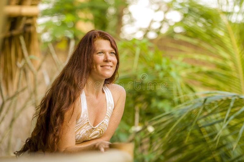 Lifestyle fresh and natural portrait of young beautiful and happy red hair woman smiling cheerful and carefree enjoying Summer. Holidays trip in tropical island stock photo