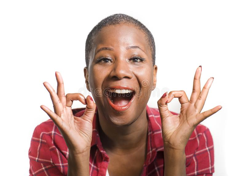 Lifestyle isolated portrait of young attractive and natural black afro american woman gesturing happy celebrating success in okay stock images