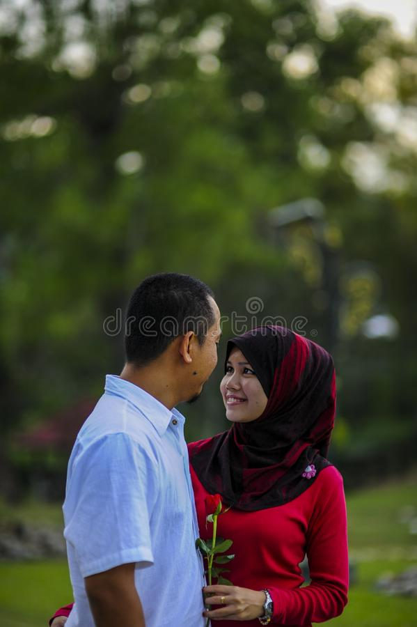 Lifestyle, happy couple of two play on a sunny day in the park royalty free stock image