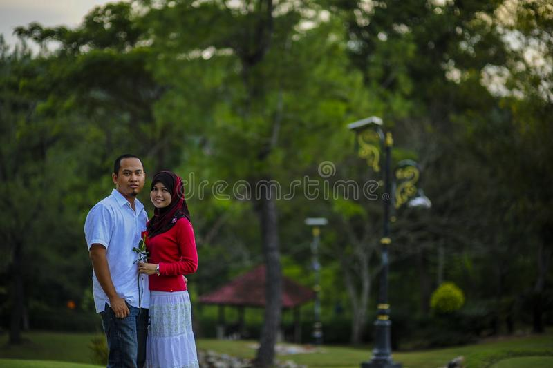 Lifestyle, happy couple of two play on a sunny day in the park royalty free stock photography