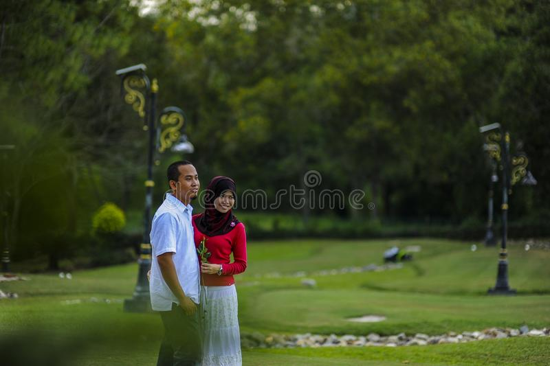 Lifestyle, happy couple of two play on a sunny day in the park stock image