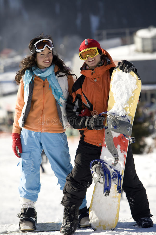 Download A Lifestyle Image Of Two Young Adult  Snowboarders Stock Photo - Image: 10429304