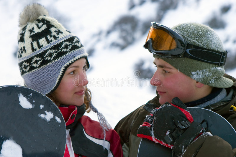 A Lifestyle Image Of Two Young Adult Snowboarders Royalty Free Stock Image
