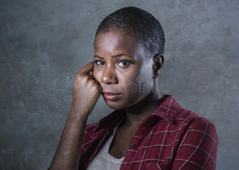 Lifestyle isolated portrait of young attractive and sad black african American woman feeling unwell and depressed and suffering pa royalty free stock photos