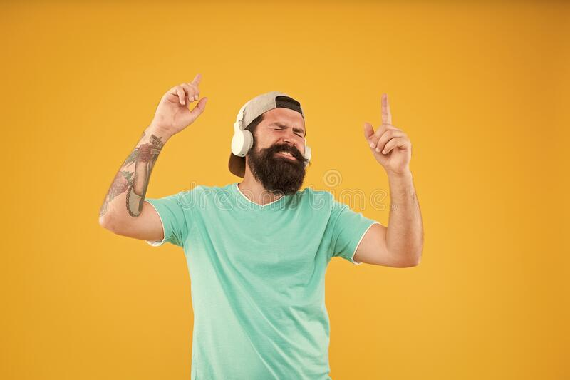 Lifestyle music fan. Man listening music wireless headphones. Bass low sound. Hipster headphones gadget. Inspiring song. Music library. Party every day. Rhythm stock photography