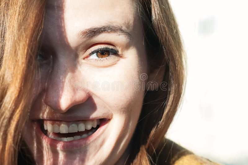Lifestyle natural beauty female portrait. Beauty portrait of chestnut heard young woman enjoying sunny day, natural make-up. Street fashion, genuine smile stock photo