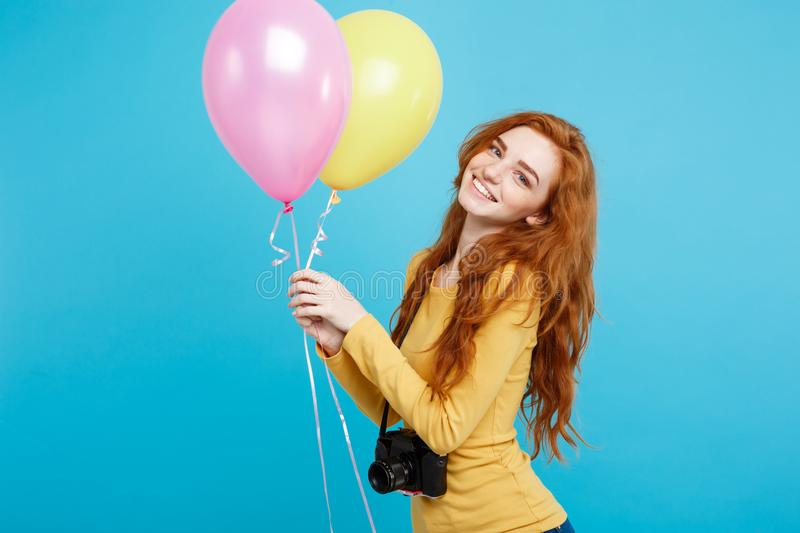 Lifestyle and Party concept - close up portrait young beautiful attractive ginger red hair girl with colorful balloon stock photos