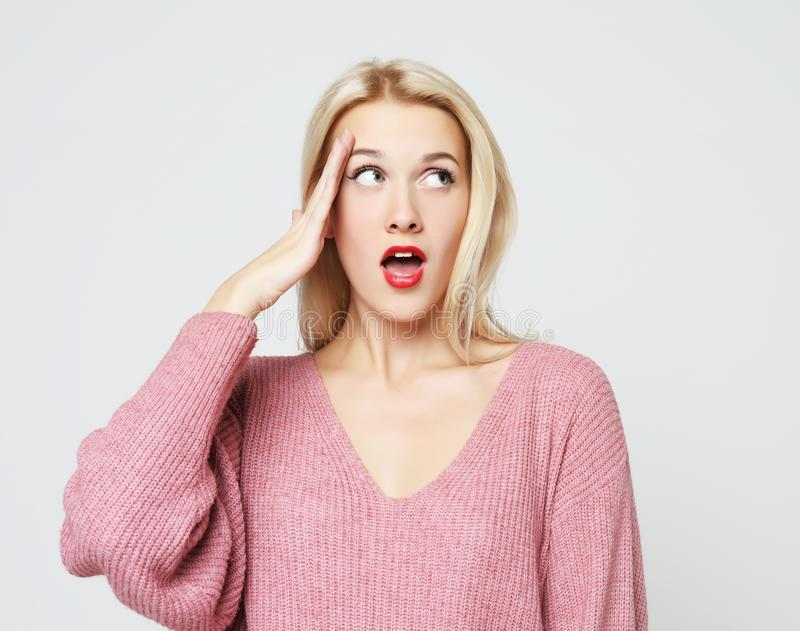 Beautiful girl surprised and shocked looks on you. stock photo