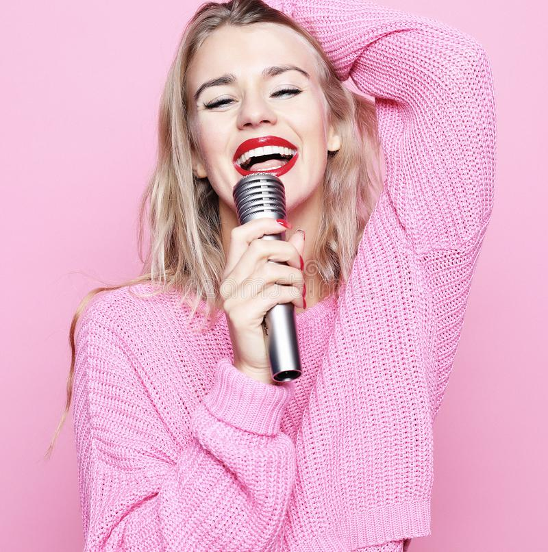 Lifestyle and people concept: Beauty model girl singer with a mi stock photos