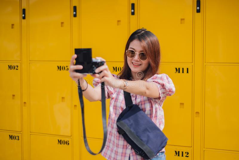 Playful young attractive woman selfie with her camera. stock images