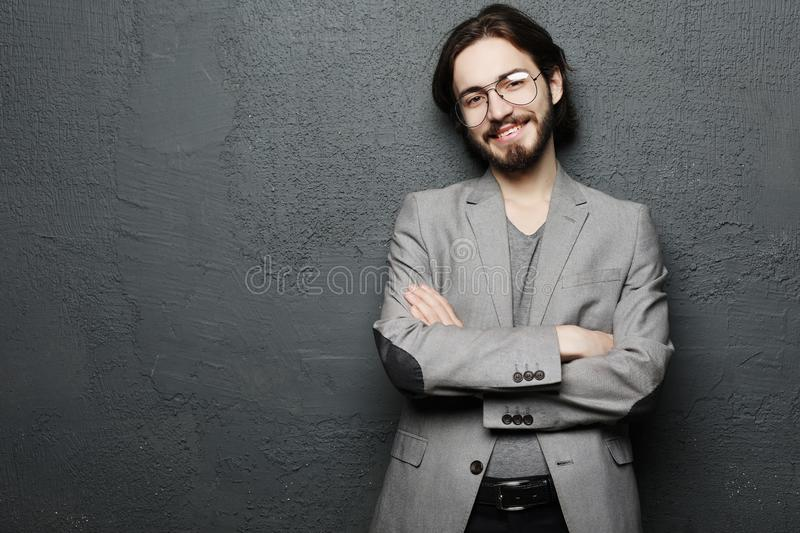 Lifestyle and people concept: Portrait of handsome young man with smile on dark background royalty free stock image