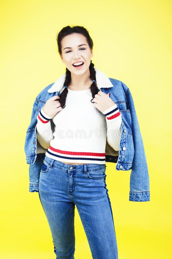 Lifestyle people concept: pretty young school teenage girl having fun happy smiling on yellow background close up stock photos