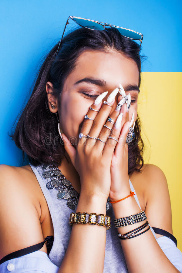 Lifestyle people concept. young pretty smiling indian girl with long nails wearing lot of jewelry rings, asian summer royalty free stock image