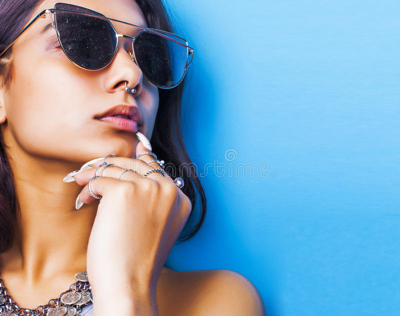 Lifestyle people concept. young pretty smiling indian girl with long nails wearing lot of jewelry rings, asian summer. Happy cool close up copyspace stock photography