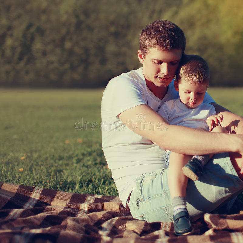 Lifestyle photo lovely father and son together resting outdoors royalty free stock photos