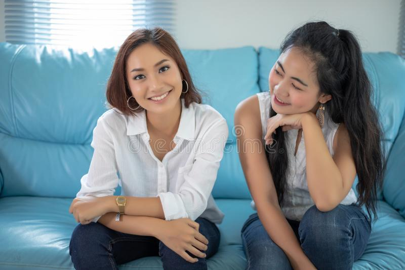 Lifestyle portrait Asian women of best friends - smiling happy on sofa at living room royalty free stock images