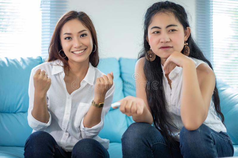 Lifestyle portrait Asian women of best friends - smiling happy on sofa at living room stock photo