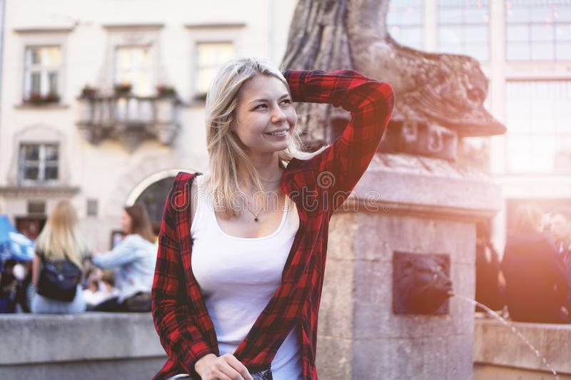 Lifestyle portrait of blonde girl wearing a rock red shirt, white t-shirt. Lifestyle portrait of fashionable happy blonde girl wearing a rock red shirt, white t stock photos