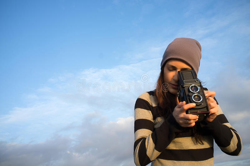 Lifestyle Portrait of Female Photographer with a Vintage Camera royalty free stock photos