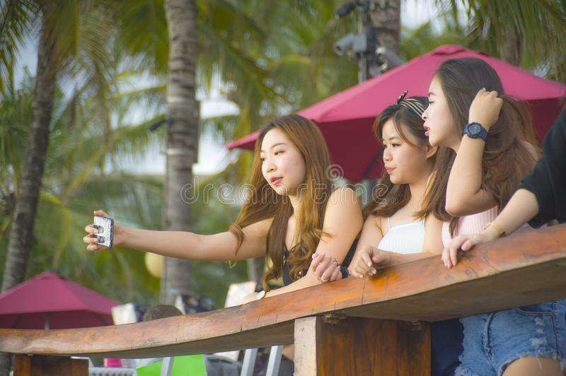 Group with young happy and attractive Asian Chinese and Korean women hanging out , girlfriends enjoying holidays trip in tropical royalty free stock photos