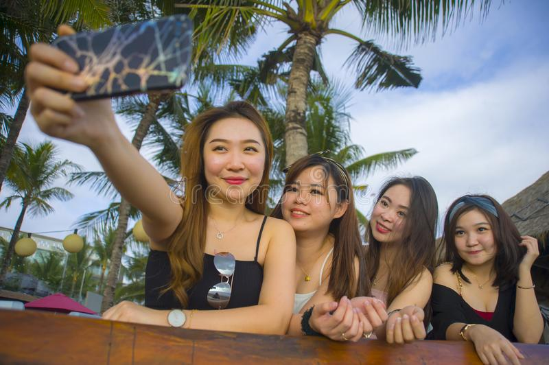 Group with young happy and attractive Asian Chinese and Korean women hanging out , girlfriends enjoying holidays trip in tropical stock images