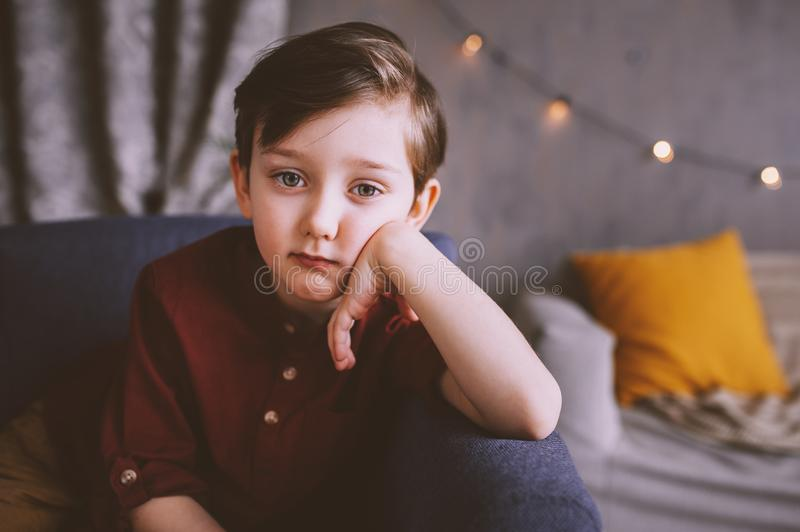 Lifestyle portrait of handsome thoughtful child boy stock image