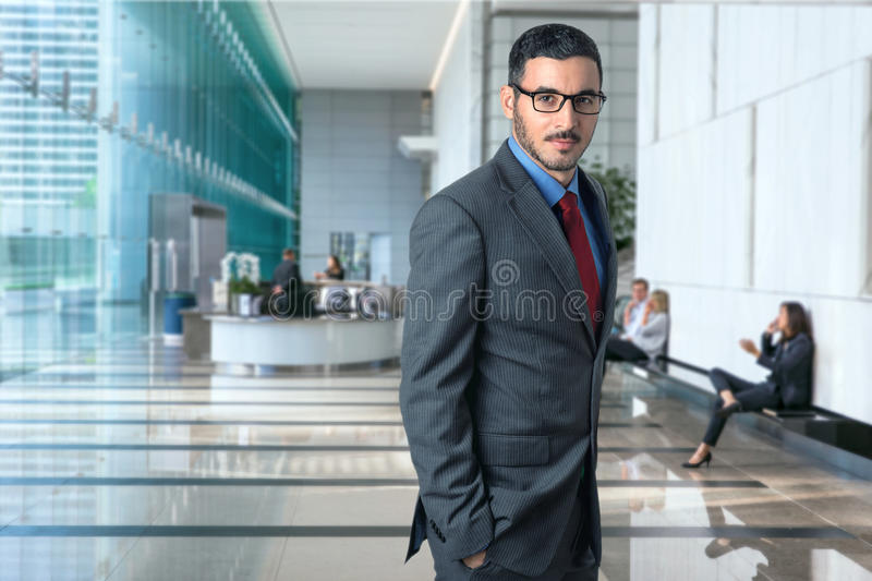 Lifestyle portrait of modern executive professional businessman attorney lawyer in business office elegant style confident royalty free stock images