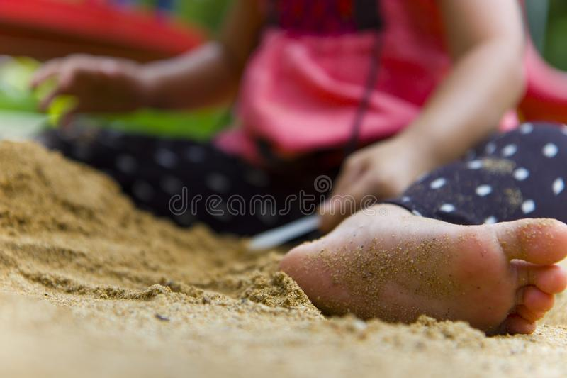 Lifestyle portrait mom son and daughter  playing with sand, Funny Asian family in a public  playground. High resolution image gallery stock image