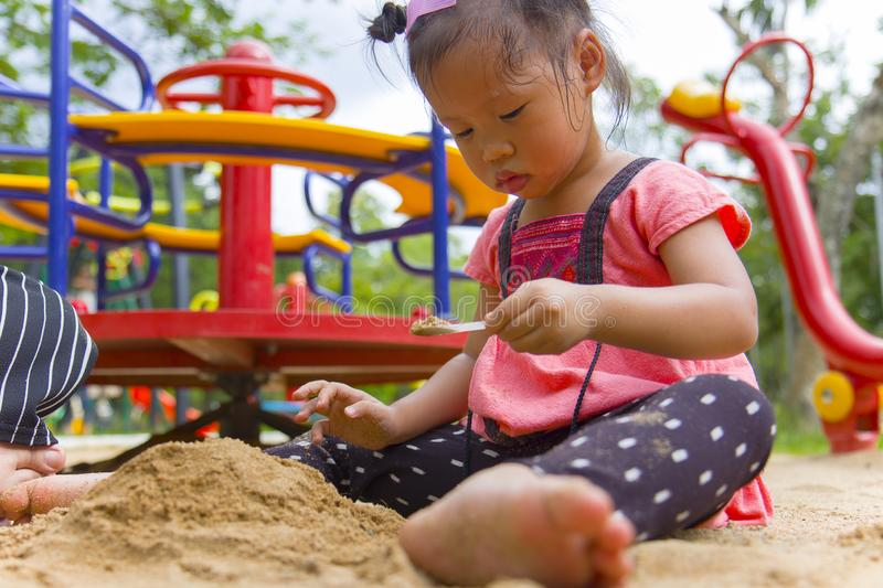 Lifestyle portrait mom son and daughter  playing with sand, Funny Asian family in a public  playground. High resolution image gallery royalty free stock images