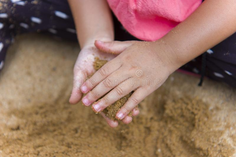 Lifestyle portrait mom son and daughter  playing with sand, Funny Asian family in a public  playground. High resolution image gallery royalty free stock image