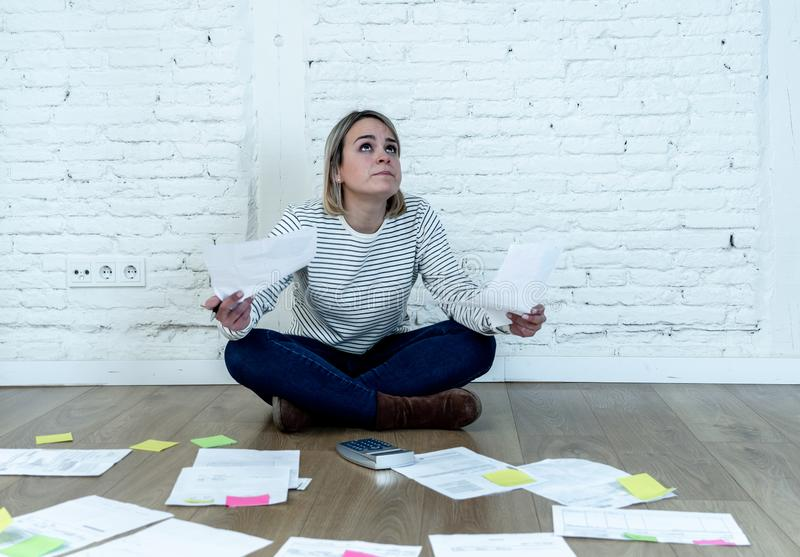 Lifestyle portrait of stressed overwhelmed young woman managing home finances and paying bills. Portrait of worried young woman feeling stressed and desperate on stock image