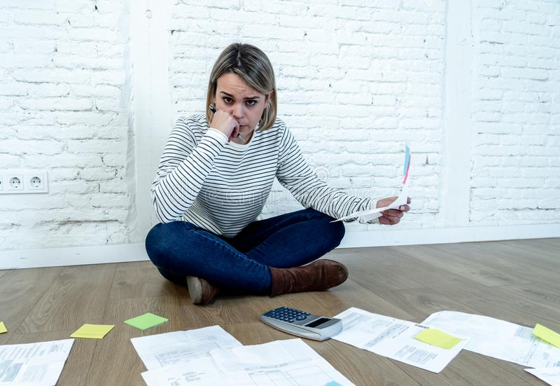 Lifestyle portrait of stressed overwhelmed young woman managing home finances and paying bills. Portrait of worried young woman feeling stressed and desperate on stock images