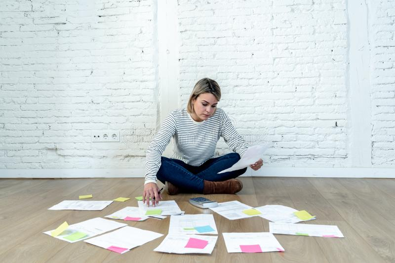 Lifestyle portrait of stressed overwhelmed young woman managing home finances and paying bills. Portrait of worried young woman feeling stressed and desperate on royalty free stock images