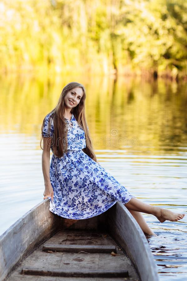 Lifestyle portrait of young beautiful woman sitting at motorboat. girl having fun at boat on the water royalty free stock images