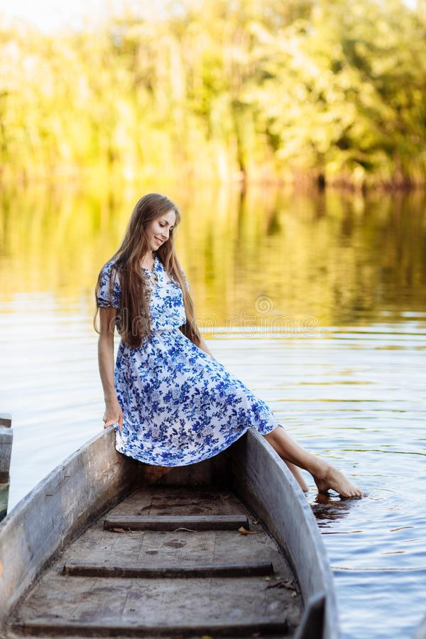 Lifestyle portrait of young beautiful woman sitting at motorboat. girl having fun at boat on the water stock images