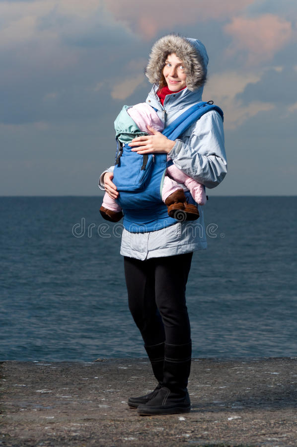 Lifestyle portrait of young mother and baby royalty free stock photography