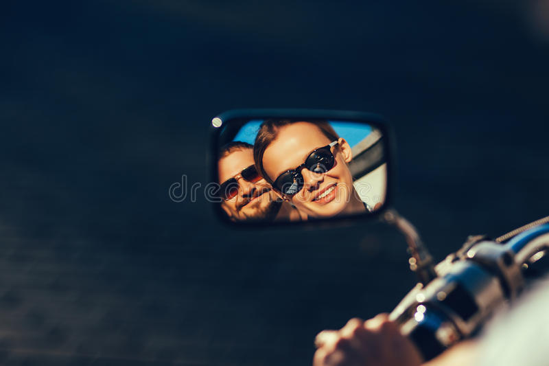 Lifestyle portrait of young perfect couple in reflection mirror stock images