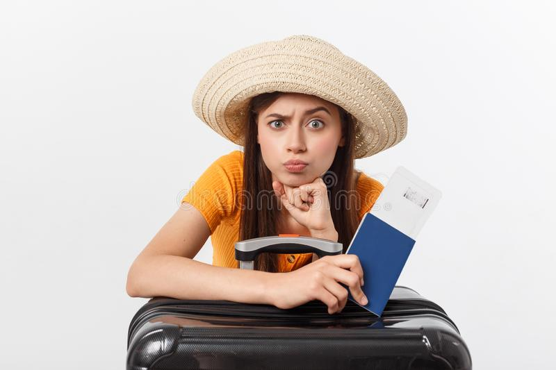 Lifestyle and travel Concept: Young beautiful caucasian woman is sitting on suitecase and waiting for her flight royalty free stock photo