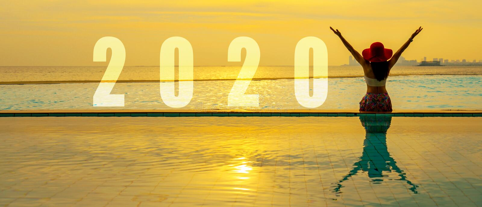 Lifestyle woman Happy New Year Card 2020. Silhouette woman relaxing and freedom on the swimming pool near the sea and beach royalty free stock image