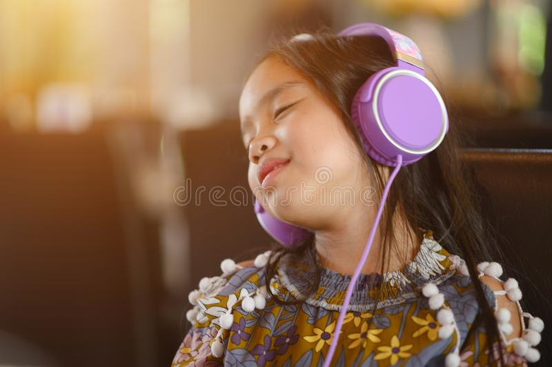 Lifestyle  Young asian girl relax  listening to music in home.  stock photography
