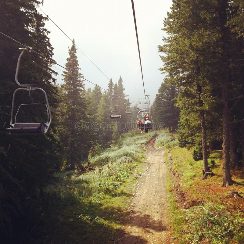 Lift in the forest. Ski chair lift in Rila national park in Bulgaria stock photography