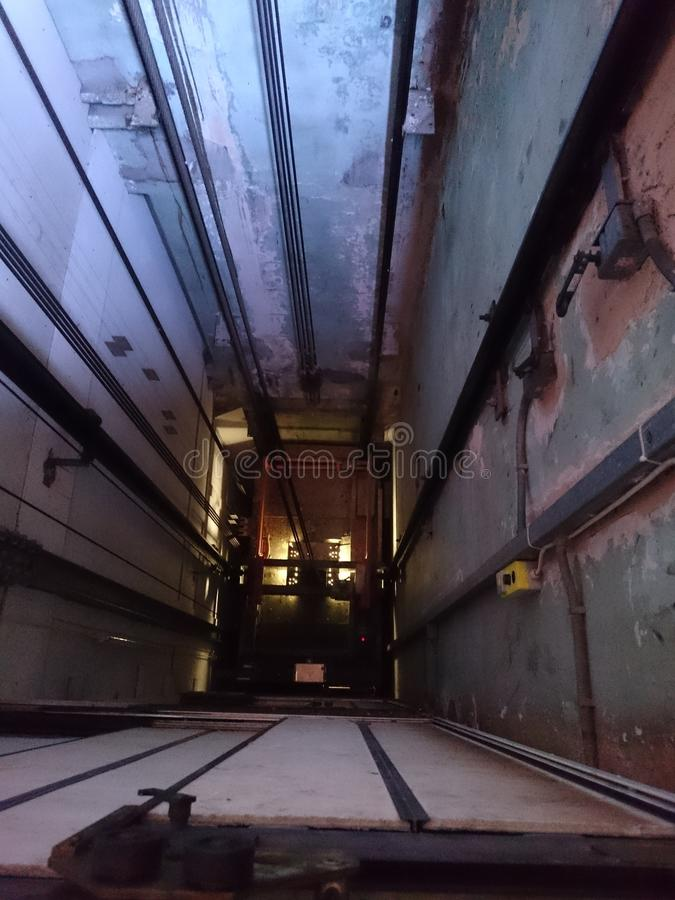 Lift shaft. Inside of a lift shaft looking down stock images