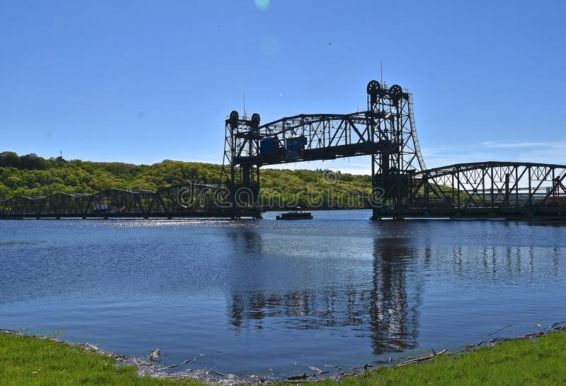 Aerial bridge with the lift up. The lift is up on an aerial bridge spanning the St. Croix River stock photos