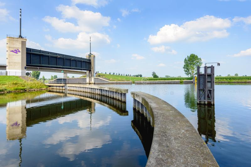 Lifted water stop gate in the Netherlands royalty free stock photos